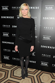 Kirsten Dunst paired a sophisticated long sleeve dress with black suede pumps.