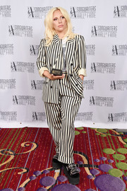 Lady Gaga couldn't be missed in her baggy black-and-white striped pantsuit at the Songwriters Hall of Fame Induction and Awards.