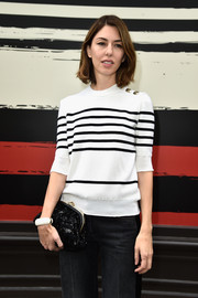 Sofia Coppola accessorized her casual outfit with a single white bangle for a simple yet stylish look during the Sonia Rykiel show.