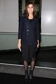 Carine Roitfeld teamed black lace-up boots with a pea coat and a fringed skirt for the Sonia Rykiel fashion show.