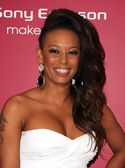 Spice girl Melanie B, flaunted her half shaven head by giving her long locks extra volume. Va-Va-Voom!