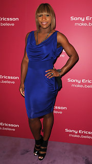 Tennis star Serena Williams made a rare showing at an industry party. She showed off her athletic figure in an electric blue dress and a pair of strappy black ankle heels.