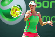 Maria Kirilenko is known for her bright tops and matching outfits.  This neon green tank was by Adidas.