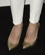Adriana Ugarte topped off her evening look with a pair of classic gold pumps.
