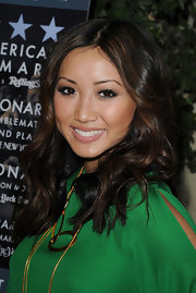 Brenda Song attended 'The Social Network' event sporting center part curls that were softly highlighted.