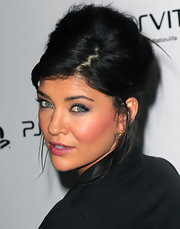 Jessica Szohr attended the Sony PlayStation unveiling of the PS VITA portable entertainment system wearing her hair in a voluminous French twist.