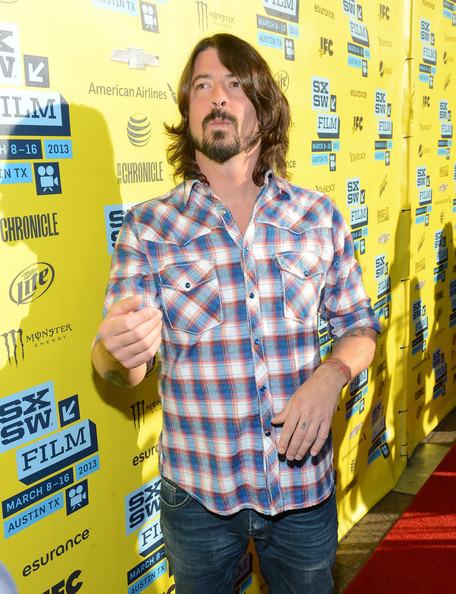 Dave Grohl kept his red carpet look super casual with a plaid button down.