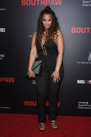 Dascha Polanco chose a gray and black envelope clutch to finish off her outfit.