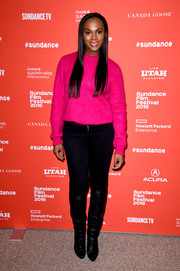 Tika Sumpter sealed off her laid-back look with a pair of black knee-high boots.