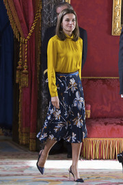 Queen Letizia of Spain balanced out her plain top with a printed skirt by Hugo Boss.