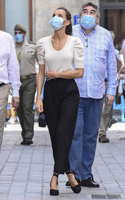 Queen Letizia kept it casual in a puff-sleeved knit top by Massimo Dutti paired with black slacks while touring Jaca, Spain.
