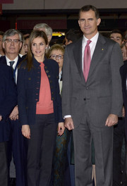 Princess Letizia went to the Alimentaria gastronomic fair wearing a blue military jacket over a pink shirt.