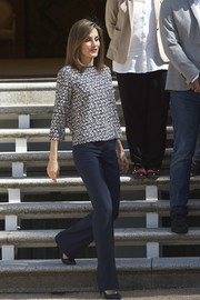 Queen Letizia of Spain was casual yet classy in a print blouse and navy slacks while attending audiences at Zarzuela Palace.