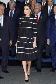 Queen Letizia of Spain looked ultra chic in a striped black cocktail dress by Carolina Herrera at the closure of World Law Congress.