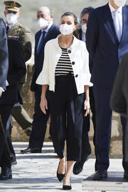 Queen Letizia of Spain layered a white swing jacket with bell sleeves over a striped shirt for her visit to Fuendetodos.
