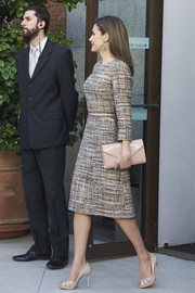 Queen Letizia of Spain opted for nude accessories, including a patent envelope clutch.