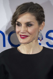 Queen Letizia of Spain added a heavy dose of glamour with a pair of diamond and ruby chandelier earrings.