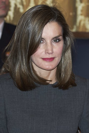 Queen Letizia of Spain finished off her look with some glossy berry lipstick.
