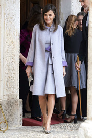 Queen Letizia of Spain looked very classy in a lilac Carolina Herrera coat layered over a matching dress at the Miguel de Cervantes Literature Awards.