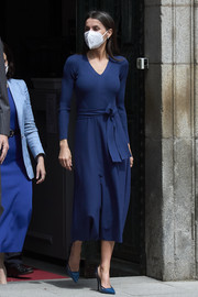 Queen Letizia of Spain visited the Cervantes Institute wearing a navy V-neck midi dress by Massimo Dutti.