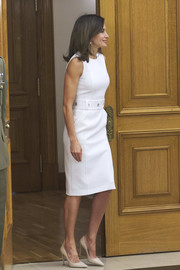 Queen Letizia of Spain donned a crisp white midi dress by Hugo Boss to attend several audiences at Zarzuela Palace.