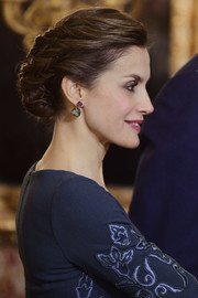 Queen Letizia of Spain complemented her updo with a beautiful pair of amethyst and tourmaline earrings.