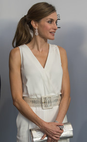 Queen Letizia of Spain styled her jumpsuit with a wide silver belt and a matching clutch for the Princesa de Girona Foundation Awards.