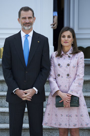 Queen Letizia of Spain accessorized with a green snakeskin clutch while hosting a lunch for the President of Mexico.