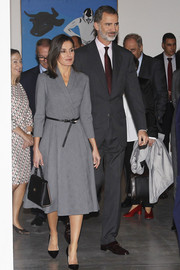 Queen Letizia polished off her ensemble with a black leather purse by Hugo Boss.
