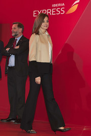Queen Letizia of Spain added an edgy touch with a pair of studded black pumps by Uterqüe.