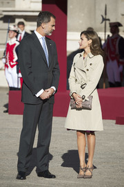 Queen Letizia of Spain completed her monochromatic ensemble with a taupe leather clutch.