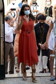 Queen Letizia of Spain looked effortlessly stylish in a sleeveless red midi dress by Adolfo Dominguez while visiting Fray Junipero Serra's museum.