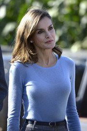 Queen Letizia of Spain accessorized her outfit with a navy skinny belt by Hugo Boss during her visit to Porenu village.