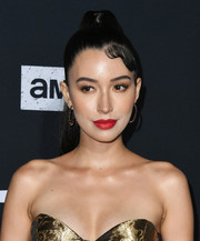 Christian Serratos rocked a glamorous ponytail at the special screening of 'The Walking Dead' season 10.