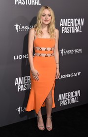 Dakota Fanning paired her dress with classic gold sandals by Tamara Mellon.