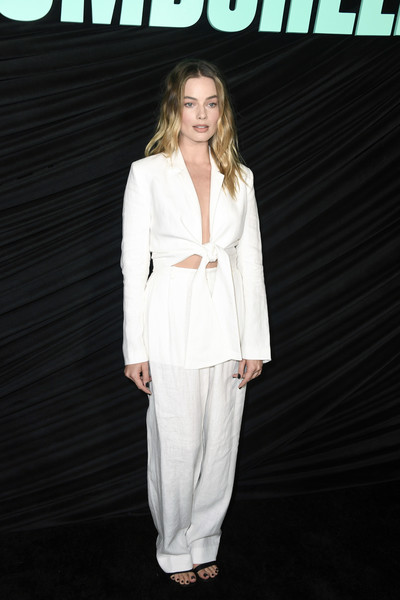 Margot Robbie looked cool in a white tie-waist jacket and pants combo by Mara Hoffman at the special screening of 'Bombshell.'