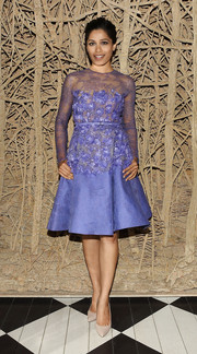 Freida Pinto was the picture of ladylike elegance in this periwinkle Elie Saab Couture confection, featuring a lace yoke and sleeves and a floral-appliqued midsection, during the 'Desert Dancer' special screening.