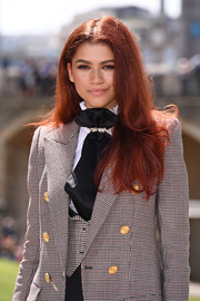 Zendaya Coleman teamed a black ascot tie with a patterned blazer and vest for the 'Spider-Man: Far From Home' photocall.