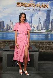 Laura Harrier donned a pink Prabal Gurung midi dress with a slashed waist and a high slit for the 'Spider-Man: Homecoming' photocall.