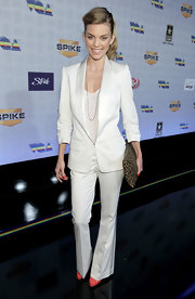 AnnaLynne shows off her slender height in this white flare leg pant suit.