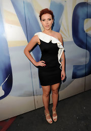 Scarlett looked sophisticated in a black and white one-shoulder cocktail dress with a ruffled neckline.