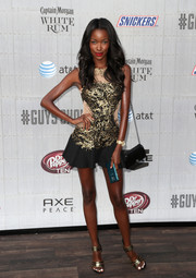 Tia Shipman polished off her ensemble with a classic black chain-strap bag.