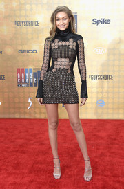Gigi Hadid polished off her look with the celeb-favorite Giuseppe Zanotti Harmony sandals, in silver.