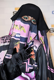 With the rest of her face covered by this couture burqa, M.I.A. relied on bright green shadow to make her eyes pop.