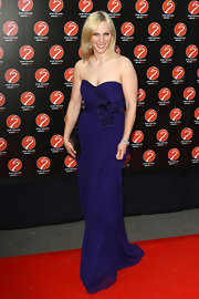 Stunning royal Zara Phillips donned a dark blue gown for the Sports Industry Awards. The strapless frock featured a sweetheart neckline and a bow detail around the waist.