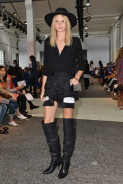 A pair of black thigh-high boots finished off Jessica Maystein's look in edgy style.