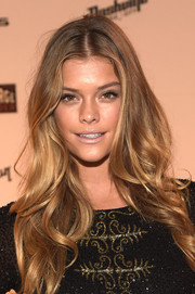 For her beauty look, Nina Agdal shunned color, opting instead for a nude lip.