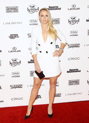 Caroline Wozniacki made an appearance at the Sports Illustrated Swimsuit 2016 celebration wearing a plunging white tux dress.