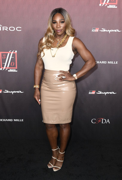 Serena Williams completed her outfit with white triple-strap heels.