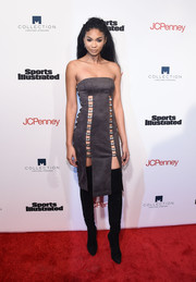 Chanel Iman put on a racy display at the SI Fashionable 50 NYC event in a strapless gray dress with flesh-revealing strips down the sides.